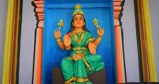 Statue of a Hindu deity with Four Arms at a temple in Lankawi Footage