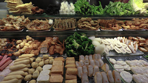 Buffet Table with Meats and Vegetables at a Restaurant in Singapore Footage