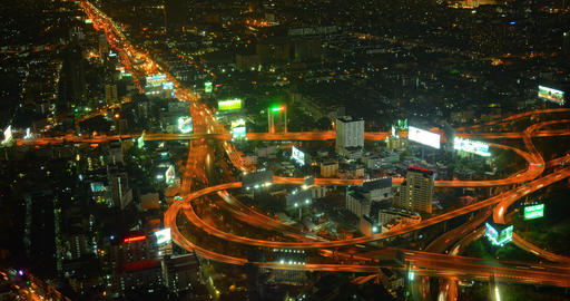 Heavy Night Time Traffic on Complex. Looping Highway Interchange in Bangkok Footage