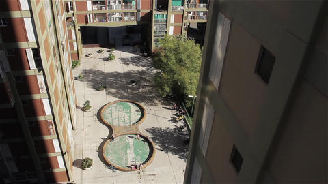 Children Playing In Housing Complex Footage