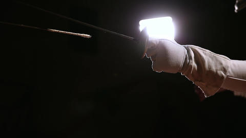 Closeup of a rapier for fencing in the hand performs offensive movements. Male Footage