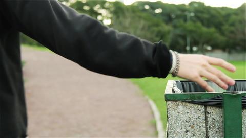 Teenagers Throwing Away Garbage In Public Trash Archivo