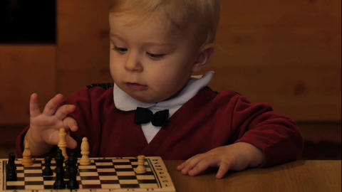 cute active smart infant baby near chess closeup Archivo