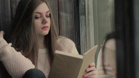 Beautiful young model read a literature turning pages of the book Image
