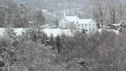 Countryside church in snow Footage