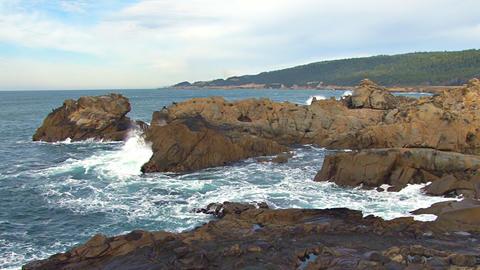 Crashing waves on rocky coastline Footage
