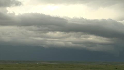 Crazy storm clouds rolling over green landscape Live Action