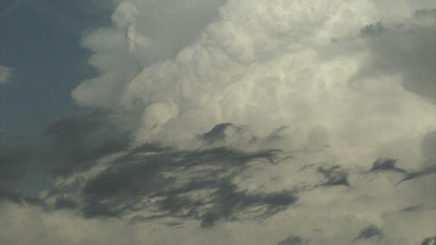Fluffy white storm clouds in the sky Footage