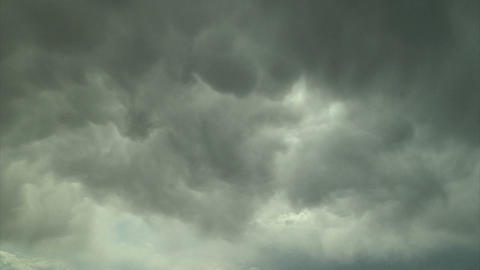 Gray storm clouds moving through sky Footage