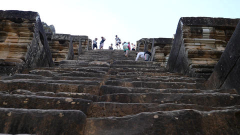Descending a steep stone staircase at Ta Keo temple Footage
