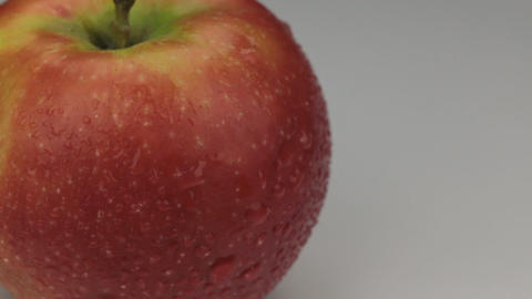 Extreme closeup red apple in drops of dew rotates on its axis Footage