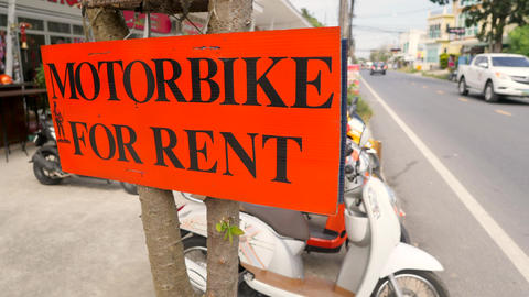 Motorbikes for Rent Street Sign at Bike Rental Shop. 4K. Thailand Footage