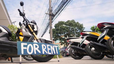 Motorbikes for Rent Sign at Bike Rental Shop. 4K. Thailand Footage