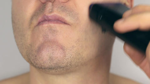 Closeup shave a man, shave electric razor, first part Footage