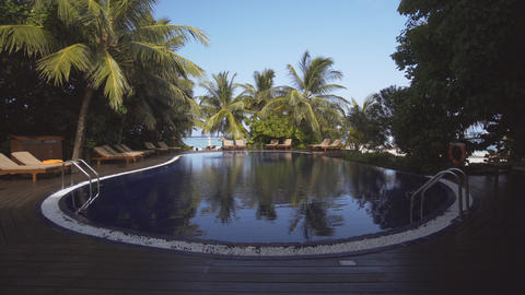 Resort Pool Overlooks Tropical Sea on Vaadhoo Island Footage
