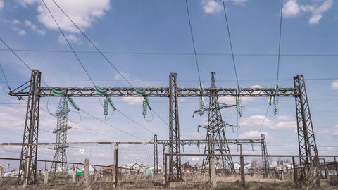 Power plant against the sky with clouds. High-voltage substation. Risk of Footage