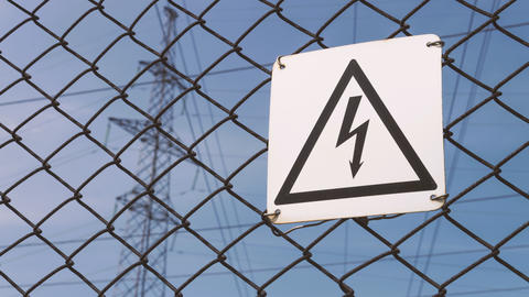 Power substation. Warning sign about the risk of electric shock. High-voltage Footage