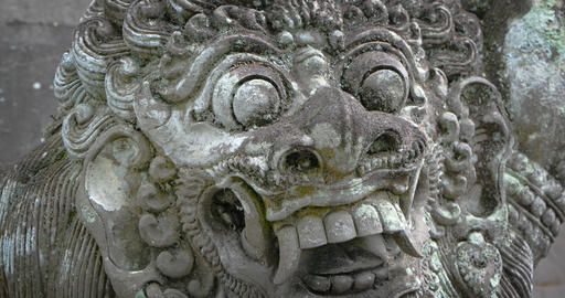 Ancient Stone Sculpture of Mythical Monster at Balinese Temple Live Action