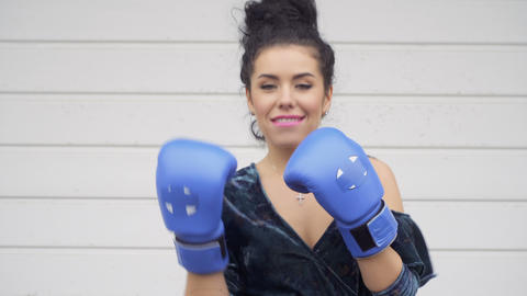 Stylish woman in dress posing for camera in boxing gloves Footage