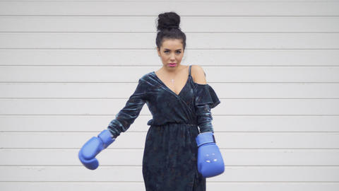 Beautiful woman wearing dress in boxing gloves Footage