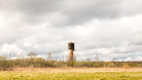 Water tower against a background of dense clouds. Time Lapse Footage