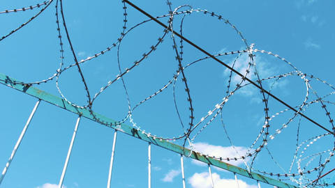 Fence with barbed wire. Fencing of the territory. Prison enterprise. Prohibition Footage