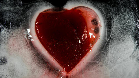 Red heart in ice melting bleeding 00194 Photo