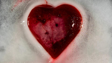 Red heart in ice melting bleeding 00090 Fotografía