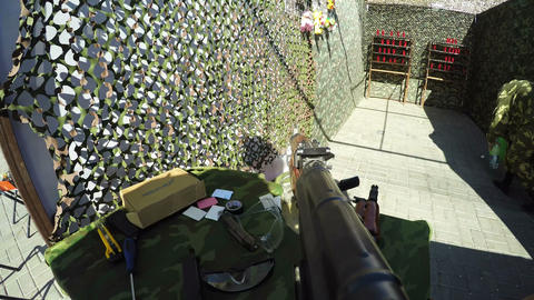 Man Takes Weapon Recharges Shoots Tins in Shooting Range Live Action