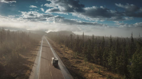 Aerial of rv driving on icefields parkway in jasper Live Action