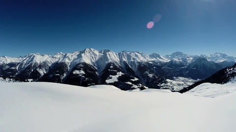 Aerial view of snow mountains snow winter landscape Live Action