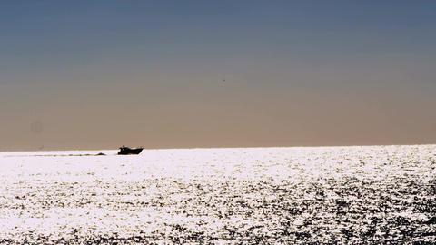 Boat on bright shimmering sea ビデオ