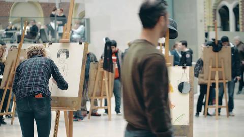 AMSTERDAM, THE NETHERLANDS - DECEMBER 26, 2017. Amateur portrait drawing contest Live Action