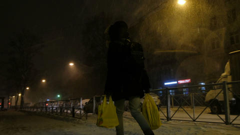 Young woman carries groceries after work, 4K Live Action