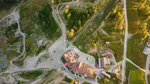 Rosa Khutor plateau, buildings, slopes and chair lifts. Aerial view at sunset, Footage