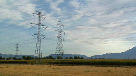 Powerlines and mountains with cornfield timelapse Footage