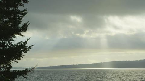 Sun shining through clouds over nova scotia bay Footage