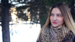 Beautiful fashionable girl walking outdoors in winter and smiling beautifully Footage