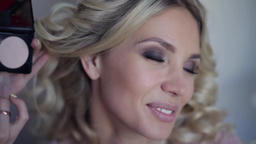 Close-up. Super beautiful sexy girl smiles during make-up in beauty salon Footage