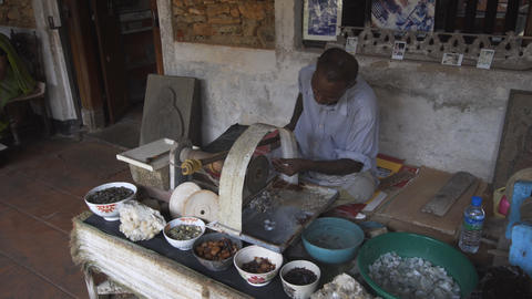 Artisan grinds and polishes moonstones in his workshop in Sri Lanka Live Action