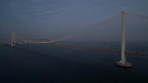 Aerial - Full view of the Akashi Kaikyo Bridge right after sunset Zoom out ライブ動画