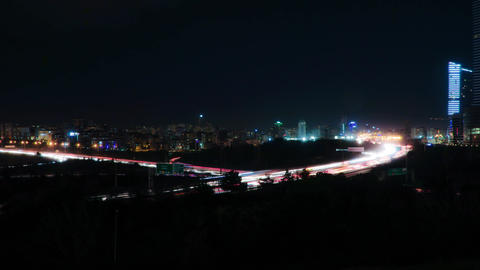 Cityscape timelapse at night. Busy traffic across the main road at rush hour Footage