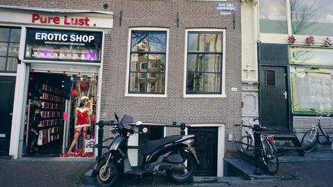 AMSTERDAM, NETHERLANDS - DECEMBER 26, 2017. Walk along local erotic shops Footage