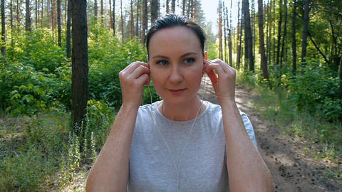 sport activities in the fresh air, headphones with music in hand Footage