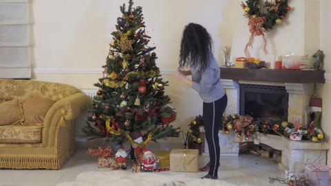 Pretty woman decorates Christmas tree Footage