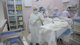 A medical team prepares a surgical room for sterilization after the operation is Footage