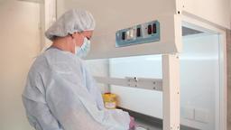 A nurse prepares a solution for chemotherapy Footage