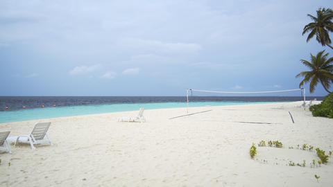 Sun Loungers and Volleyball Net on a Beach in the Maldives Footage