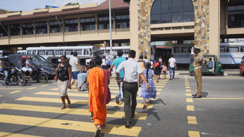Police officer stops traffic for pedestrians in downtown Galle Footage