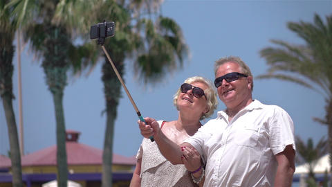 Video of senior couple taking a selfie picture in real slow motion Image